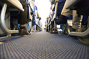 low angle view of passengers in an airplanes economy class