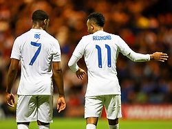 Nathan Redmond of England U21 talks to Jordan Ibe during the game - Mandatory byline: Matt McNulty/JMP - 07966386802 - 03/09/2015 - FOOTBALL - Deepdale Stadium -Preston,England - England U21 v USA U23 - U21 International
