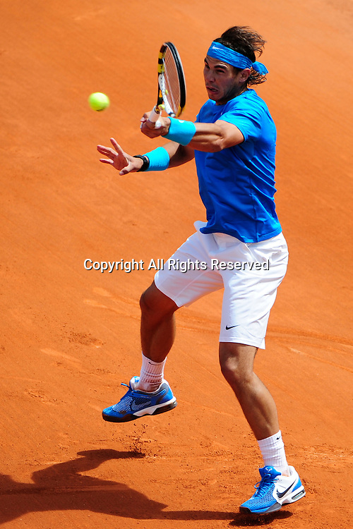 24.05.2011 French Open Tennis from Roland Garros Paris. Rafael Nadal of Spain returns a shot in his match against John Isner of the USA on day three of the French Open tennis championships.