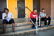 "(L to R) Kasey Brown, Kyle Simon and Jessie Cole hang out on the steps of the Grambling State University Natatorium in Grambling, Louisiana on October 23, 2013. The natatorium is boarded up with most windows broken out but plans to renovate the building into a new Health and Wellness Center are ""coming soon.""   (Cooper Neill for The New York Times)"