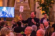New York, NY - 10 December 2013. Stewart Rahr making a bid at the Prostate Cancer Foundation gala auction at the Plaza Hotel.