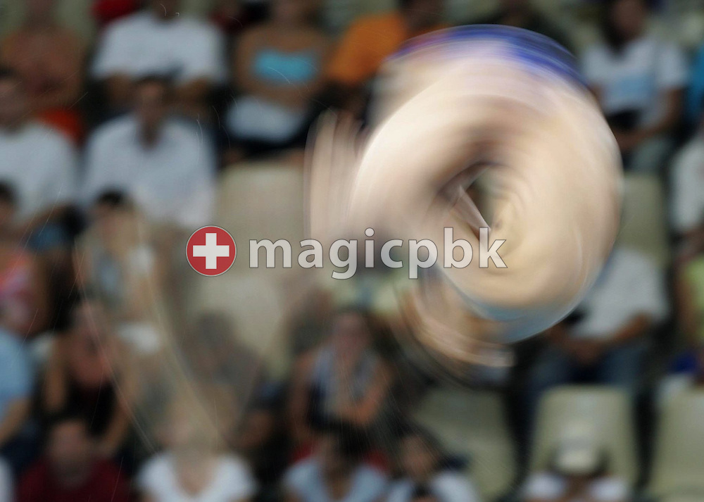 Liang Tian from China performs during the men's 10m Platform Preliminary Diving at the Olympic Aquatic Centre in Athens, Friday 27 August 2004. Tian is third ranked before the finals.       (Photo by Patrick B. Kraemer / MAGICPBK)