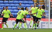Brighton central midfielder, Dale Stephens scores a goal and celebrates with team mates during the Sky Bet Championship match between Bolton Wanderers and Brighton and Hove Albion at the Macron Stadium, Bolton, England on 26 September 2015.