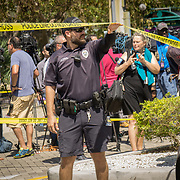 HOLLYWOOD, FL - [SEPTEMBER 13, 2017]: <br /> Hollywood Police Department officers direct traffic outside  perimeter surrounding a rehabilitation center in the city where 6 patients died on September 12, 2017 in Hollywood, United States. (Photo by Angel Valentin/Getty Images)