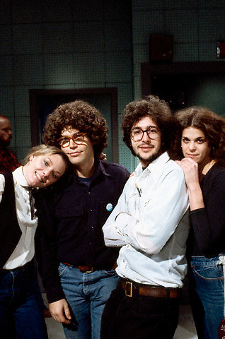 ca. 1977-1979 --- NBC's Saturday Night Live cast (from left to right) Jane Curtin, Al Franken, Tom Davis, and Gilda Radner. --- Image by © Owen Franken