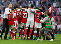 Football - 2017 FA Cup Final - Arsenal vs. Chelsea<br /> <br /> Arsenal Manager Arsene Wenger  hugs Alexis Sanchez as the Arsenal team celebrate at Wembley.<br /> <br /> COLORSPORT/DANIEL BEARHAM