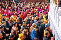 China, Wutai Shan, 2008. Hundreds of monks from all over China line up to pay their respects. Some will receive new robes and meet old friends at Tayuan Temple's annual lunar calendar celebration in April.