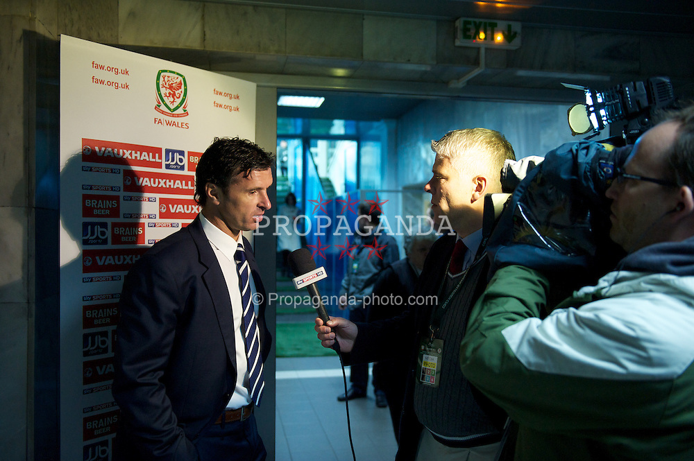 SOFIA, BULGARIA - Tuesday, October 11, 2011: Wales' manager Gary Speed MBE speaks to Sky Sports in the flash interview area after the 1-0 victory over Bulgaria in the UEFA Euro 2012 Qualifying Group G match at the Vasil Levski National Stadium. (Pic by David Rawcliffe/Propaganda)