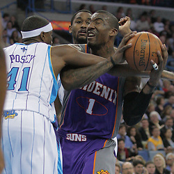 03 December 2008:  New Orleans Hornets forward James Posey (41) fouls Phoenix Suns forward Amare Stoudemire (1) during the first half of a NBA regular season game between the Phoenix Suns and the New Orleans Hornets at the New Orleans Arena in New Orleans, LA..