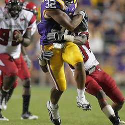 19 September 2009: LSU Tigers running back Charles Scott (32) runs against the Louisiana-Lafayette Cajuns defense during 31-3 win by the LSU Tigers over the University of Louisiana Lafayette Ragin' Cajuns at Tiger Stadium in Baton Rouge, Louisiana.