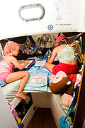 Maddy, left and Emma have some drawing time in their room which is in the bow of the boat.