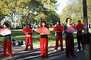 BROOKLYN, NY - October 3, 2014: Ladies performing morning exercises in Sunset Park.<br /> <br /> Credit: Clay Williams.<br /> <br /> © Clay Williams / http://claywilliamsphoto.com