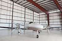 Private airplane parked in hangar
