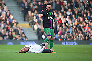 Fulham midfielder and captain, Scott Parker (08) injured with Bristol City striker, Lee Tomlin (9) looking on during the Sky Bet Championship match between Fulham and Bristol City at Craven Cottage, London, England on 12 March 2016. Photo by Matthew Redman.