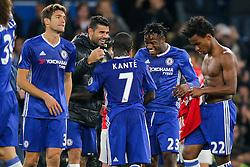Diego Costa and Michy Batshuayi congratulate goalscorer N'Golo Kante after Chelsea win 4-0 - Rogan Thomson/JMP - 23/10/2016 - FOOTBALL - Stamford Bridge Stadium - London, England - Chelsea v Manchester United - Premier League.