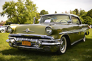 Old Westbury, New York, U.S. - June 1, 2014 -  A green 1957 Pontiac Star Chief, owner ANTHONY CACCAMO, is an entry at the Antique and Collectible Auto Show held on the historic grounds of elegant Old Westbury Gardens in Long Island, and sponsored by Greater New York Region AACA Antique Automobile Club of America.