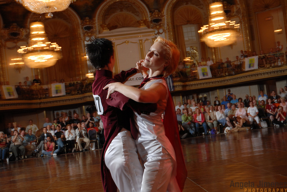 Lesbian ballroom dancers Sunny Williams, left, of Sacramento, California, and Emily Coles, of San Francisco, California, compete during the Dancesport ballroom dancing competition at the Hilton Hotel and Towers in downtown Chicago during Gay Games VII on July 20, 2006. ..Over 12,000 gay and lesbian athletes from 60 countries are in Chicago competing in 30 sports during the Games from July 15 through 22, 2006. ..Over 50,000 athletes have competed in the quadrennial Games since they were founded by Dr. Tom Wadell, a 1968 Olympic decathlete, and a group of friends in San Francisco in 1982, with the goal of using athletics to promote community building and social change. ..The Gay Games resemble the Olympics in structure, but the spirit is one of inclusion, rather than exclusivity. There are no qualifying events or minimum or maximum requirements...The Games have been held in Vancouver (1990), New York (1994), Amsterdam (1998), and Sydney (2002). .