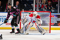 KELOWNA, BC - SEPTEMBER 21:  Leif Mattson #28 of the Kelowna Rockets looks for the pass ahead of Campbell Arnold #1 of the Spokane Chiefs at Prospera Place on September 21, 2019 in Kelowna, Canada. (Photo by Marissa Baecker/Shoot the Breeze)