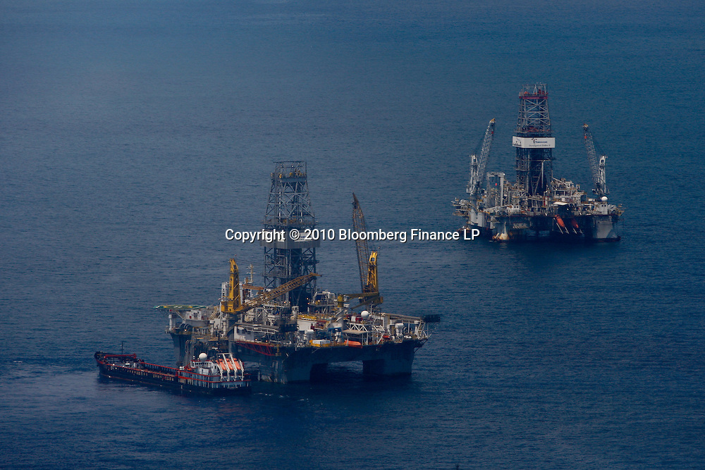 The Transocean Development Driller III and Development Driller II rigs leased by BP Plc which are drilling relief well at the BP Plc Macondo well site in the Gulf of Mexico off the coast of Louisiana, U.S., on Saturday, August 7, 2010. BP successfully used the 'static kill', procedure  pumping mud into the top of the damaged well, BP plans now to finish a relief well to permanently plug the well by mid-August. Photographer: Derick E. Hingle/Bloomberg