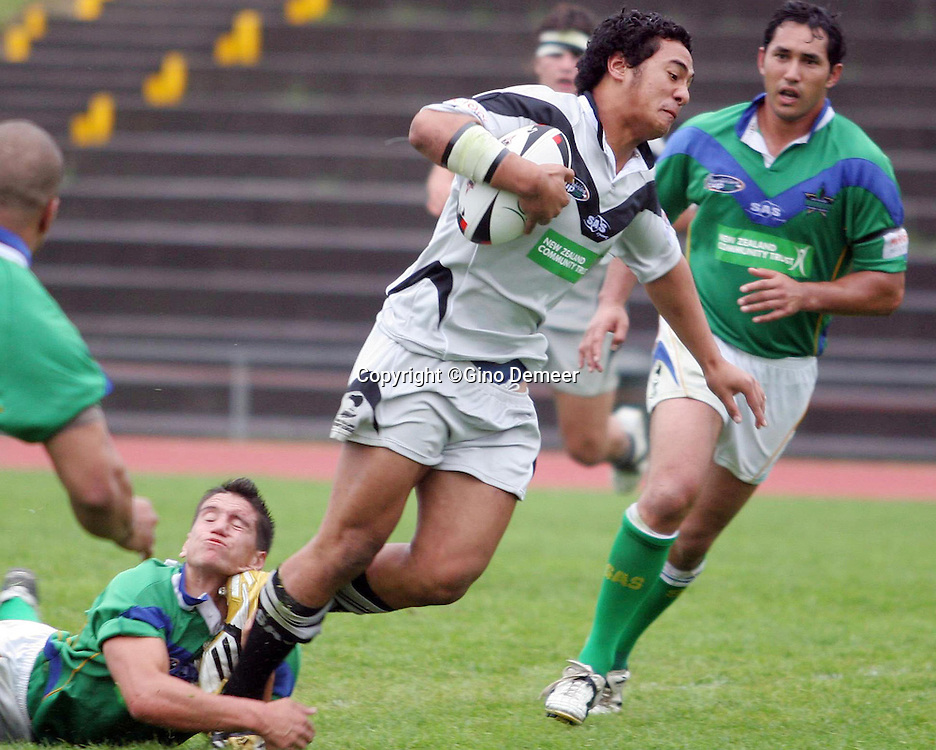 Ricky Hurunui breaking a tackle during the Barter Card Cup Rugby League game between Waitakere Rangers and Central Falcons at Waitakere Stadium, Auckland on Sunday 2nd April, 2006. Waitakere won the match 32-30. Photo:Gino Demeer/PHOTOSPORT