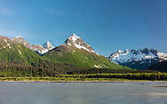 Evening light on Chugach Mountains and Lowe River near Valdez in Southcental Alaska. Summer.