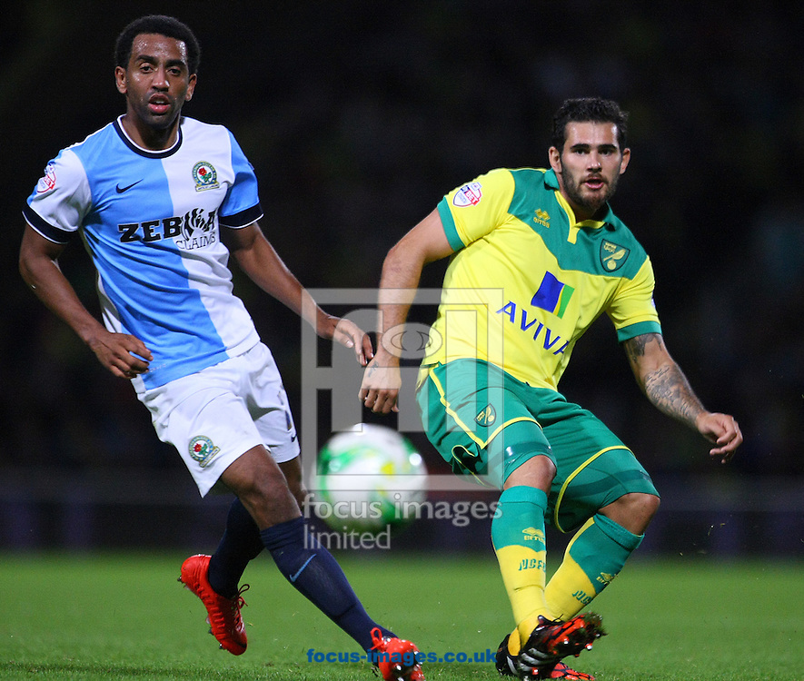 Lee Williamson of Blackburn Rovers and Bradley Johnson of Norwich in action during the Sky Bet Championship match at Carrow Road, Norwich<br /> Picture by Paul Chesterton/Focus Images Ltd +44 7904 640267<br /> 19/08/2014