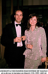 VISCOUNT & VISCOUNTESS MACKINTOSH OF HALIFAX at a dinner in London on March 11th 1997.LWZ 44
