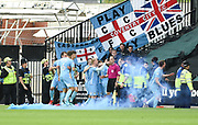 A blue flare is let off as the the Sky Blues celebrate after scoring an early goal during the EFL Sky Bet League 2 match between Notts County and Coventry City at Meadow Lane, Nottingham, England on 18 May 2018. Picture by Jon Hobley.