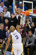 Golden State Warriors forward David West (3) dunks the ball against the LA Clippers at Oracle Arena in Oakland, Calif., on February 23, 2017. (Stan Olszewski/Special to S.F. Examiner)