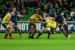 March 30, 2018 - Melbourne, VIC, U.S. - MELBOURNE, AUSTRALIA - MARCH 30 : Vaea Fifita of the Wellington Hurricanes  is tackled by 2 Rebel players during Round 7 of the Super Rugby Series between the Melbourne Rebels and the Wellington Hurricanes on March 30, 2018, at AAMI Park in Melbourne, Australia. (Photo by Jason Heidrich/Icon Sportswire) (Credit Image: © Jason Heidrich/Icon SMI via ZUMA Press)