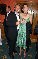 DANNY MCCALL and LADY EYZIE CECIL at the Butterfly Ball in aid of the NSPCC held at The Intercontinental Hotel, Park Lane, London on 9th September 2005.<br />