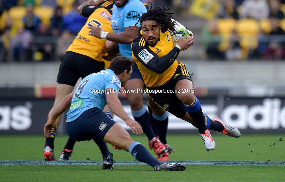 Hurricanes' inside centre Ma'a Nonu (R is tackled by Waratahs' Nick Phipps during the Super Rugby - Hurricanes v Waratahs rugby union match at the Westpac Stadium in Wellington on Saturday the 18th of April 2015. Photo by Marty Melville / www.Photosport.co.nz