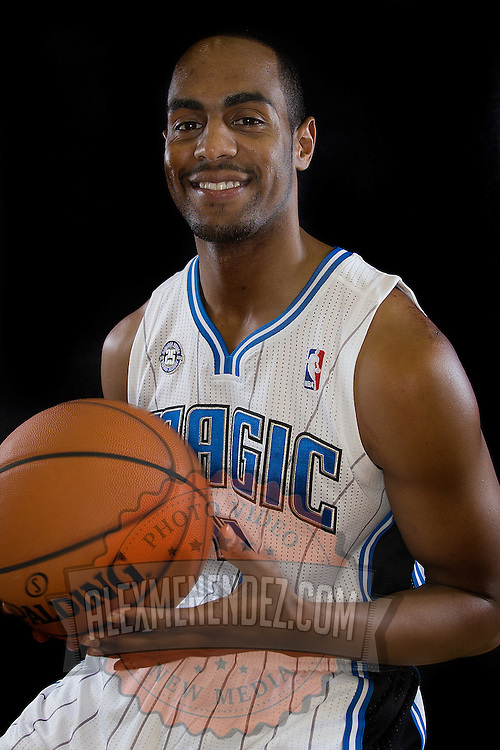 Arron Afflalo poses in front of a backdrop during the Orlando Magic media day event at the Amway Arena on Monday, September 30, 2103 in Orlando, Florida. (AP Photo/Alex Menendez)