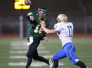 Kennedy's James Lizarraga (18) throws the ball over Wahlert's Sam Koenig (17) during the first half of the game between Cedar Rapids Kennedy and Dubuque Wahlert at Kingston Stadium in Cedar Rapids on Friday night, October 21, 2011.