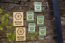 London, UK. 18 July, 2019. Signs positioned by climate activists from Extinction Rebellion close to Heathrow's 'masterplan' consultation event in Lambeth during a protest against plans for a third runway at Heathrow airport.