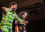 Michael Ofori, a 2nd year graduate student, and Kombe Kapatamoyo, dance at the International Dinner in Baker University Ballroom on Saturday, November 17, 2012. Students of many different races and religions game together to enjoy one night of multicultural food and entertainment.