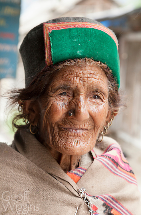 Elderly Indian woman in traditional dress from Himalayan region of Himachal Pradesh
