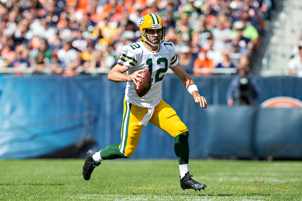 CHICAGO, IL - SEPTEMBER 13:  Aaron Rodgers #12 of the Green Bay Packers rolls out looking for a receiver during a game against the Chicago Bears at Soldier Field on September 13, 2015 in Chicago, Illinois.  The Packers defeated the Bears 31-23.  (Photo by Wesley Hitt/Getty Images) *** Local Caption *** Aaron Rodgers