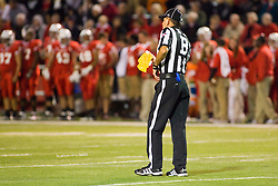 24 September 2011: Back Judge Roger Quinlan returns his infraction flag to his belt during an NCAA football game between the South Dakota State Jackrabbits (SDSU) and the Illinois State Redbirds (ISU) at Hancock Stadium in Normal Illinois.
