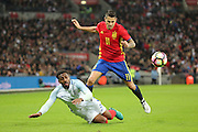Spain striker Vitolo (11) fouling England defender Danny Rose (03) during the Friendly match between England and Spain at Wembley Stadium, London, England on 15 November 2016. Photo by Matthew Redman.