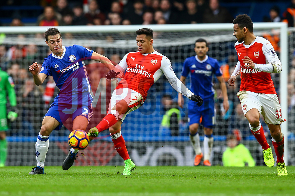 Alexis Sanchez of Arsenal passes under pressure from Cesar Azpilicueta of Chelsea - Mandatory by-line: Jason Brown/JMP - 04/01/2017 - FOOTBALL - Stamford Bridge - London, England - Chelsea v Arsenal - Premier League