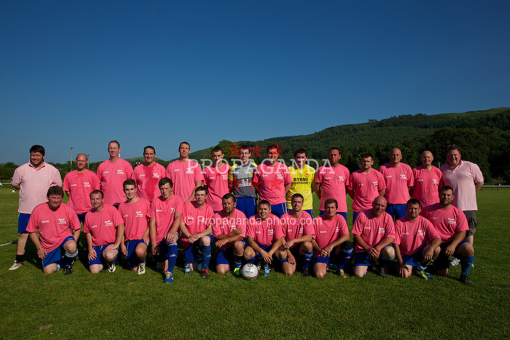 MACHYNLLETH, WALES - Tuesday, July 9, 2013: Machynlleth FC players before a charity football match in aid of the April Jones Fund. (Pic by David Rawcliffe/Propaganda)