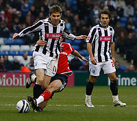 Photo: Steve Bond/Sportsbeat Images.<br /> West Bromwich Albion v Charlton Athletic. Coca Cola Championship. 15/12/2007. Zoltan Gera (L) is tackled by Matthew Holland