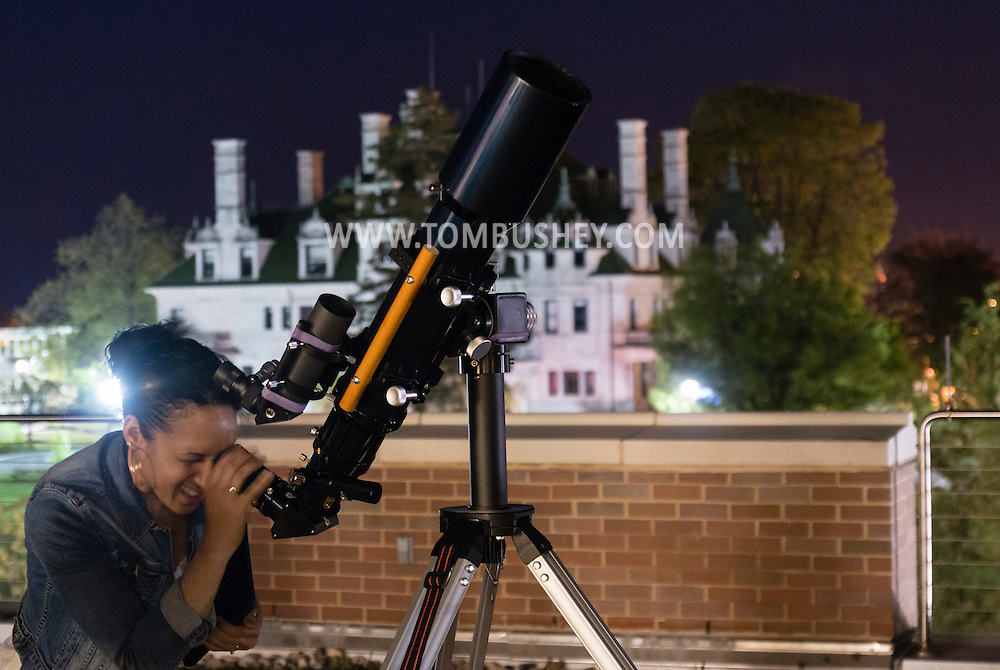 Middletown, New York - People enjoy an astronomy program on viewing constellations and planets on the Green Patio of the Rowley Center for Science and Engineering on the Middletown campus on May 12, 2015. The program was run by SUNY Orange adjunct assistant professor Tom Blom and sponsored by SUNY Orange Cultural Affairs.