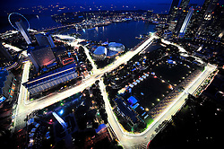 epa01501944 Formula One cars race around the Singapore Grand Prix circuit during practice rounds on 26 September 2008. Singapore will host the Grand Prix street circuit race for the first time on 28 September. It will also be the sport's first race held at night.  EPA/HOW HWEE YOUNG