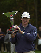 19/10/2003 - Photo  Peter Spurrier.2003 HSBC World Match Play Championship - Wentworth.Sunday - Final Day- Ernie Els v Thomas Bjorn:.Ernie Els hold's the trophy up, after winning on the 14th of the afternoon round......[Mandatory Credit Peter Spurrier/ Intersport Images]