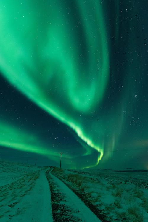 Aurora Borealis over a mountain road