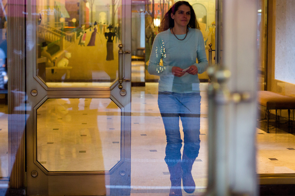 Kate exits the lobby, cheque in hand, of an apartment block in Lower Manhattan where a regular home-delivery customer lives. Many home delivery customers, such as this one, have been guests of the Stony Creek's summer farm stay.