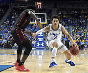 Nov 15, 2019; Los Angeles, CA, USA; UCLA Bruins guard Jules Bernard (3) is defended by UNLV Rebels forward Donnie Tillman (2)  in the second half at Pauley Pavilion. UCLA defeated UNLV 71-54.