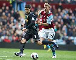 BIRMINGHAM, ENGLAND - Easter Sunday, March 31, 2013: Liverpool's Luis Alberto Suarez Diaz in action against Aston Villa's Nathan Baker during the Premiership match at Villa Park. (Pic by David Rawcliffe/Propaganda)